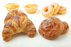 Croissant cake and donuts Stock Images