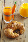 Croissant and carrot juice snack Royalty Free Stock Photography