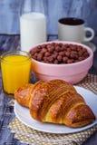 Croissant, cereal flake, coffee, milk, orange juice, boiled egg Stock Photo