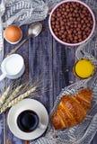 Croissant, cereal flake, coffee, milk, orange juice, boiled egg Royalty Free Stock Image