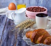 Croissant, cereal flake, coffee, milk, orange juice, boiled egg Stock Images