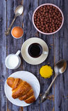 Croissant, cereal flake, coffee, milk, orange juice, boiled egg Royalty Free Stock Photo