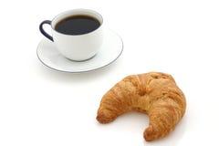 Croissant, chávena de café imagem de stock royalty free