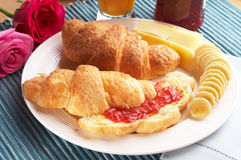 Croissant with cheese Stock Images