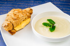 Croissant with cheese and porridge with mint Royalty Free Stock Photography