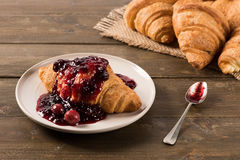 Croissant with cherry jam Royalty Free Stock Photo