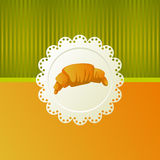 Croissant with chocolate. On a white napkin om orange background Stock Photography
