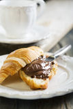 Croissant with chocolate for breakfast. Stock Images