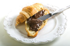 Croissant with chocolate paste. Stock Photography