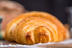 Croissant close up view in the bakery Stock Images