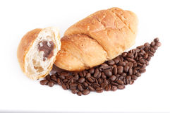 Croissant with coffe beans on white background Royalty Free Stock Images