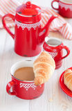 Croissant and coffee. For breakfast, selective focus Royalty Free Stock Image