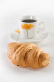 Croissant and Coffee. Croissant and a coup of coffee Stock Photos