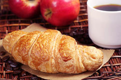 Croissant with coffee and apples Stock Images
