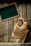 Croissant, coffee and a blank school slate Royalty Free Stock Photography