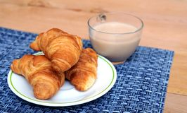 Croissant and coffee for breakfast Stock Photography