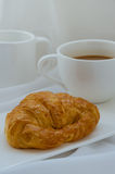 Croissant and Coffee for Breakfast. Fresh croissant and hot coffee for breakfast Stock Image