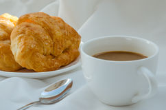 Croissant and Coffee for Breakfast. Fresh croissant and hot coffee for breakfast Royalty Free Stock Photos