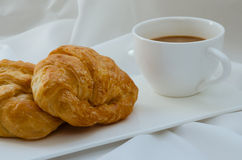 Croissant and Coffee for Breakfast. Fresh croissant and hot coffee for breakfast Royalty Free Stock Images