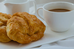 Croissant and Coffee for Breakfast. Fresh croissant and hot coffee for breakfast Royalty Free Stock Photography