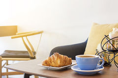 Croissant and coffee for breakfast Stock Image