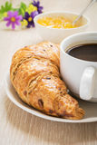 Croissant, coffee cup and fruit jam Royalty Free Stock Photo