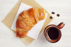Croissant and coffee cup Stock Photo