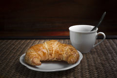Croissant and coffee cup Royalty Free Stock Images