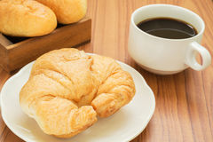 Croissant and coffee cup Stock Photography