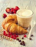 Croissant and coffee, fresh berries, healthy tasty breakfast Royalty Free Stock Image