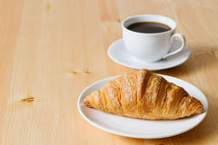 Croissant and coffee Stock Images