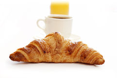 Croissant,coffee and juice Stock Photos