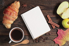 Croissant with coffee and opened notepad Stock Photo