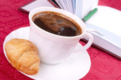 Croissant, coffee and planner Stock Photos