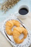 Croissant with coffee. Croissant on silver tray with coffee Stock Photography