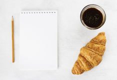 Croissant and coffee on a white background. Top view Stock Image