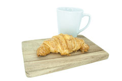Croissant and coffee on wooden in white background Stock Photo