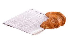 Croissant con il giornale Immagine Stock Libera da Diritti