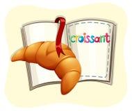 Croissant cozido e um livro ilustração do vetor