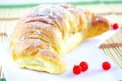 Croissant with cream Stock Photo