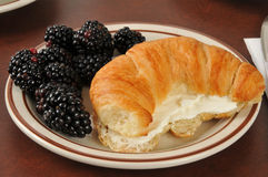 Croissant with cream cheese and blackberries Stock Photography