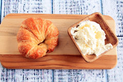 Croissant with cream cheese and bowl Stock Image