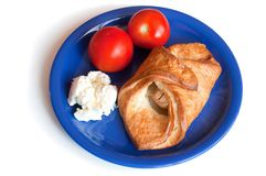 Croissant, cream cheese and tomatoes on a plate Royalty Free Stock Photos