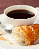 Croissant and a cup of coffee Stock Images