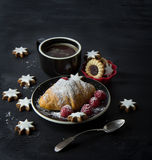 Croissant and cup of coffee on black background Royalty Free Stock Photos
