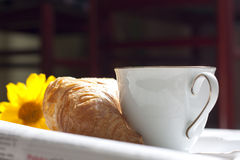 Croissant and cup of coffee breakfast in the morning Royalty Free Stock Image