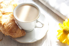 Croissant and cup of coffee breakfast in the morning Stock Photography