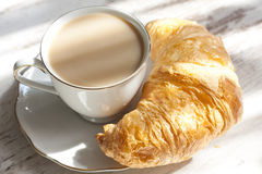 Croissant and cup of coffee breakfast in the morning Stock Images