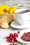 Croissant and cup of coffee breakfast in the morning Royalty Free Stock Photography