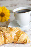 Croissant and cup of coffee breakfast in the morning Stock Photo